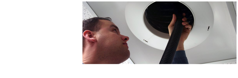 Man cleaning air duct